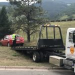 West Vail Shell Helping police tow a car