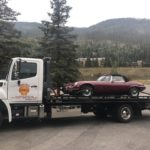 West Vail Shell towing jeep