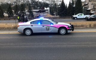 Cop handling accident on Vail Pass