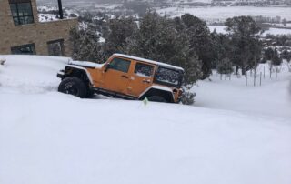Jeep in deep snow needing a tow
